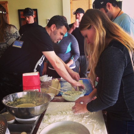 Chef Rob Kinneen (left) instructs campers on how to roll out ravioli nudi dough.