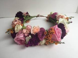 Roses, wax flower, carnation and lisianthus make up this flower crown fit for a goddess. Designed by Natasha Price of alaskaknitnat.com.