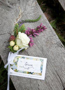 Alaska Weddings: Emily & Dan: bountonnières of spray roses, hypericum, foraged hemlock, lilac, veronica and feathers | Flowers by Natasha of Alaskaknitnat.com