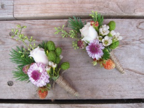 Boutonnieres made with spray rose, lavender button mum, white waxflower, eucalyptus, spruce, wild strawberries and alder cones | designed by Natasha Price of alaskaknitnat.com