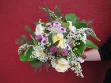 Wild Alaska bridal bouquet with garden roses, lavender button mums, wildflowers, alder, spruce, salal, seeded eucalyptus and a four-leaf clover | designed by Natasha Price of Alaskaknitnat.com