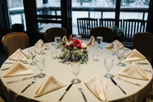 Red and white wintertime centerpiece designed by Natasha Price of Alaskaknitnat.com | Photo by Grace Adams Photography