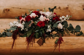 Altar centerpieces in burgundy and ivory | Designed by Natasha Price and photo by Grace Adams Photography