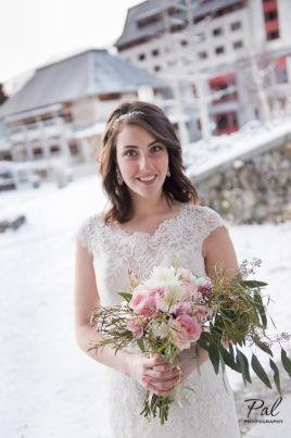 Winter weddings: a bridal bouquet with eucalyptus, alstroemeria, roses, spider mums, carnations and wax flower. Designed by Natasha Price of Alaskaknitnat.com