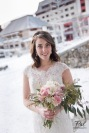 Winter weddings: a bridal bouquet with eucalyptus, alstroemeria, roses, spider mums, carnations and wax flower. Designed by Natasha Price of Alaskaknitnat.com