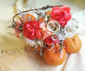Tangerine crown made with spray roses, mini carnations and limonium (statice)   created by Natasha Price of Alaskaknitnat.com