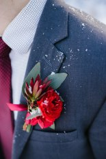 Boutonniere made with ranunculus, leucadendron and eucalyptus | designed by Natasha Price of Alaskaknitnat.com and photo by Sara Olivia Photographer
