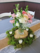 Wedding centerpieces made with blush garden roses, lisianthus, carnations, queen anne's lace, stock, alestroemeria and myrtle | Wedding flowers designed by Natasha Price of Alaskaknitnat.com