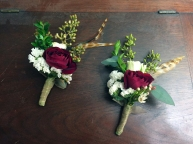 Alaska Winter Wedding | eucalyptus, spray rose, white statice, mini myrtle and a touch of feathers make an elegant, festive boutonnière. Designed by Natasha Price from alaskaknitnat.com