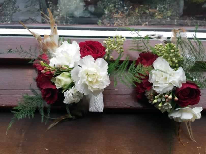 Alaska Winter Wedding  spray rose, white statice, carnation, eucalyptus, festive corsage. Designed by Natasha Price from alaskaknitnat.com