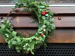 Alaska Winter Wedding: flower crown made with white wax flower, plumosa, eucalyptus, mini myrtle, red hypericum, white statice, and red and white spray roses. It's like a holiday wreath for your head! Designed by Natasha Price of alaskaknitnat.com