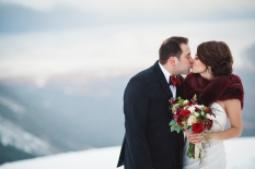 Alaska Winter Wedding | White and red roses, white and burgundy carnations, eucalyptus, red snapdragon, red hypericum, plumosa and spray roses. The perfect holiday bouquet from alaskaknitnat.com