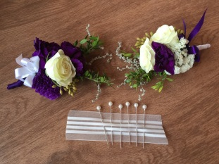 Alaska Winter Wedding | corsages made with white spray roses, statice, sage, mini myrtle, eucalyptus and purple mini carnations. Designed by Natasha Price of Alaskaknitnat.com