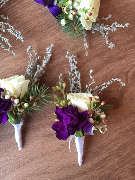 Alaska Winter Wedding | boutonnieres made with white spray roses, statice, sage, waxflower, Sitka spruce, eucalyptus and purple mini carnations. Designed by Natasha Price of Alaskaknitnat.com
