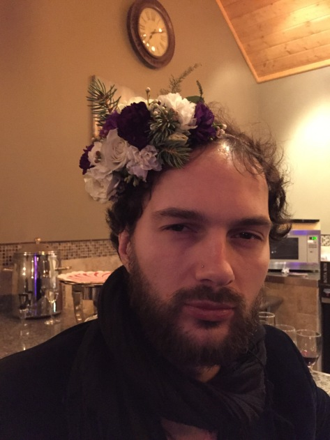 Alaska Winter Wedding   flower crown made with white spray roses, statice, mini myrtle, waxflower, Sitka spruce, eucalyptus and purple mini carnations. Designed by Natasha Price of Alaskaknitnat.com