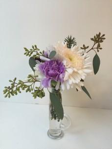 Winter Weddings: Purple carnations, white chrysanthemums, spruce sprigs and eucalyptus create a soft, festive look for any winter celebration | designed by Natasha Price of Alaskaknitnat.com