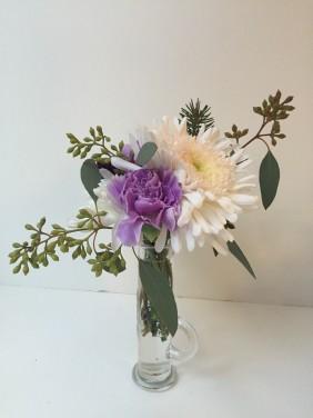 Winter Weddings: Purple carnations, white chrysanthemums, spruce sprigs and eucalyptus create a soft, festive look for any winter celebration   designed by Natasha Price of Alaskaknitnat.com