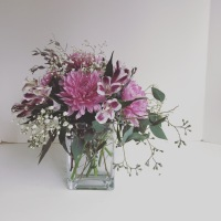 DIY Mother's Day arrangement   Make a beautiful floral centerpiece in just a few simple steps using eucalyptus, baby's breath, alstroemeria and football mums. Tutorial by alaskaknitnat.com