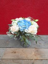 Garden roses, blue hydrangea, lisianthus, baby's breath limonium, seeded eucalyptus and dusty miller   Such a romantic, soft palate for a June wedding. Designed by Natasha Price of Alaskaknitnat.com