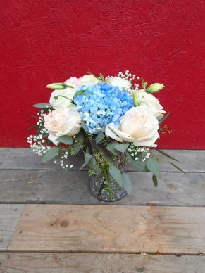 Garden roses, blue hydrangea, lisianthus, baby's breath limonium, seeded eucalyptus and dusty miller | Such a romantic, soft palate for a June wedding. Designed by Natasha Price of Alaskaknitnat.com