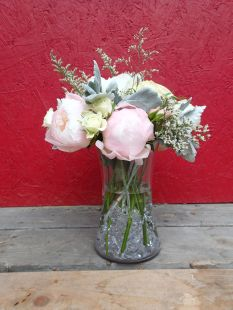 Wedding bouquet with peonies, garden roses, lisianthus, spray roses, limonium, salal and seeded eucalyptus   a romantic flower arrangement with a soft palate, designed by Natasha Price of Alaskaknitnat.com