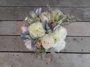 Wedding bouquet with peonies, garden roses, lisianthus, spray roses, limonium, salal and seeded eucalyptus | a romantic flower arrangement with a soft palate, designed by Natasha Price of Alaskaknitnat.com