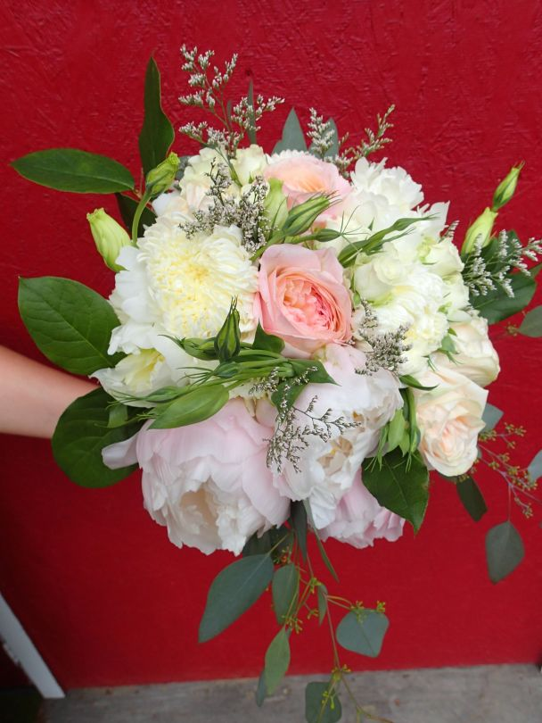 Bridal bouquet with peonies, garden roses, lisianthus, spray roses, limonium, salal and seeded eucalyptus   a romantic flower arrangement with a soft palate, designed by Natasha Price of Alaskaknitnat.com