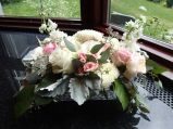 Wedding centerpiece made with garden roses, spray roses, football mums, stock, lisianthus, limonium, dusty miller, salal and seeded eucalyptus | designed by Natasha Price of Alaskaknitnat.com