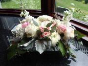 Wedding centerpiece made with garden roses, spray roses, football mums, stock, lisianthus, limonium, dusty miller, salal and seeded eucalyptus | designed by Natasha Price of Alaskaknitnat.com