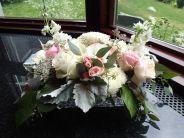 Wedding centerpiece made with garden roses, spray roses, football mums, stock, lisianthus, limonium, dusty miller, salal and seeded eucalyptus   designed by Natasha Price of Alaskaknitnat.com