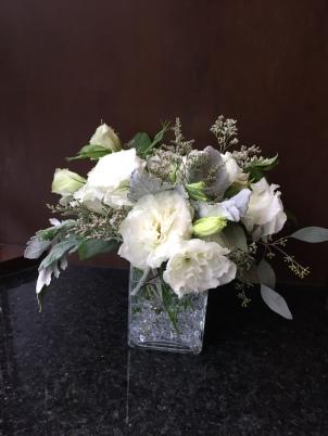 Centerpieces made with lisianthus, dusty miller, limonium and seeded eucalyptus | Wedding flowers designed by Natasha Price of Alaskaknitnat.com