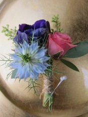 Boutonniere made with nigella, purple anemone, spray rose and seeded eucalyptus | designed by Natasha Price of Alaksaknitnat.com