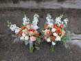 A creamsicle wedding | bridal bouquet made with peach roses, football mums, snapdragon, spray roses, lisianthus, limonium, hypericum, safflower and seeded eucalyptus. Designed by Natasha Price of Alaskaknitnat.com