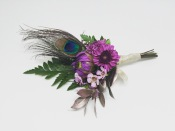 Boutonniere made with button mums, dahlia bud, waxflower, fern and peacock feather | designed by Natasha Price of alaskaknitnat.com
