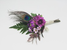 Boutonniere made with button mums, dahlia bud, waxflower, fern and peacock feather   designed by Natasha Price of alaskaknitnat.com