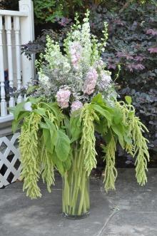 Large flower arrangement made with larkspur, stock, limonium and trailing amaranthus | designed by Evan Falconer of Paper Peony and Natasha Price of Alaskaknitnat.com