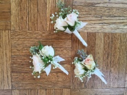 boutonnieres made with white and blush spray roses, seeded eucalyptus and baby's breath | designed by Natasha Price of Alaskaknitnat.com