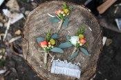 Autumn boutonnieres with orange spray rose, billy ball, hypericum, solidago and seeded eucalyptus | designed by Natasha Price of alaskaknitnat.com