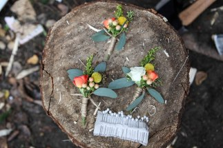 Autumn boutonnieres with orange spray rose, billy ball, hypericum, solidago and seeded eucalyptus | designed by Natasha Price of alaskaknitnat.com