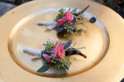 Shabby chic wedding boutonnieres made with limonium, eucalyptus, feathers and spray roses | Designed by Natasha Price of alaskaknitnat.com