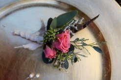 Shabby chic wedding boutonnieres made with limonium, eucalyptus, feathers and spray roses | Designed by Natasha Price of alaskaknitnat.com