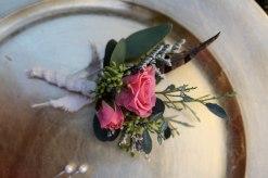 Shabby chic wedding boutonnieres made with limonium, eucalyptus, feathers and spray roses   Designed by Natasha Price of alaskaknitnat.com