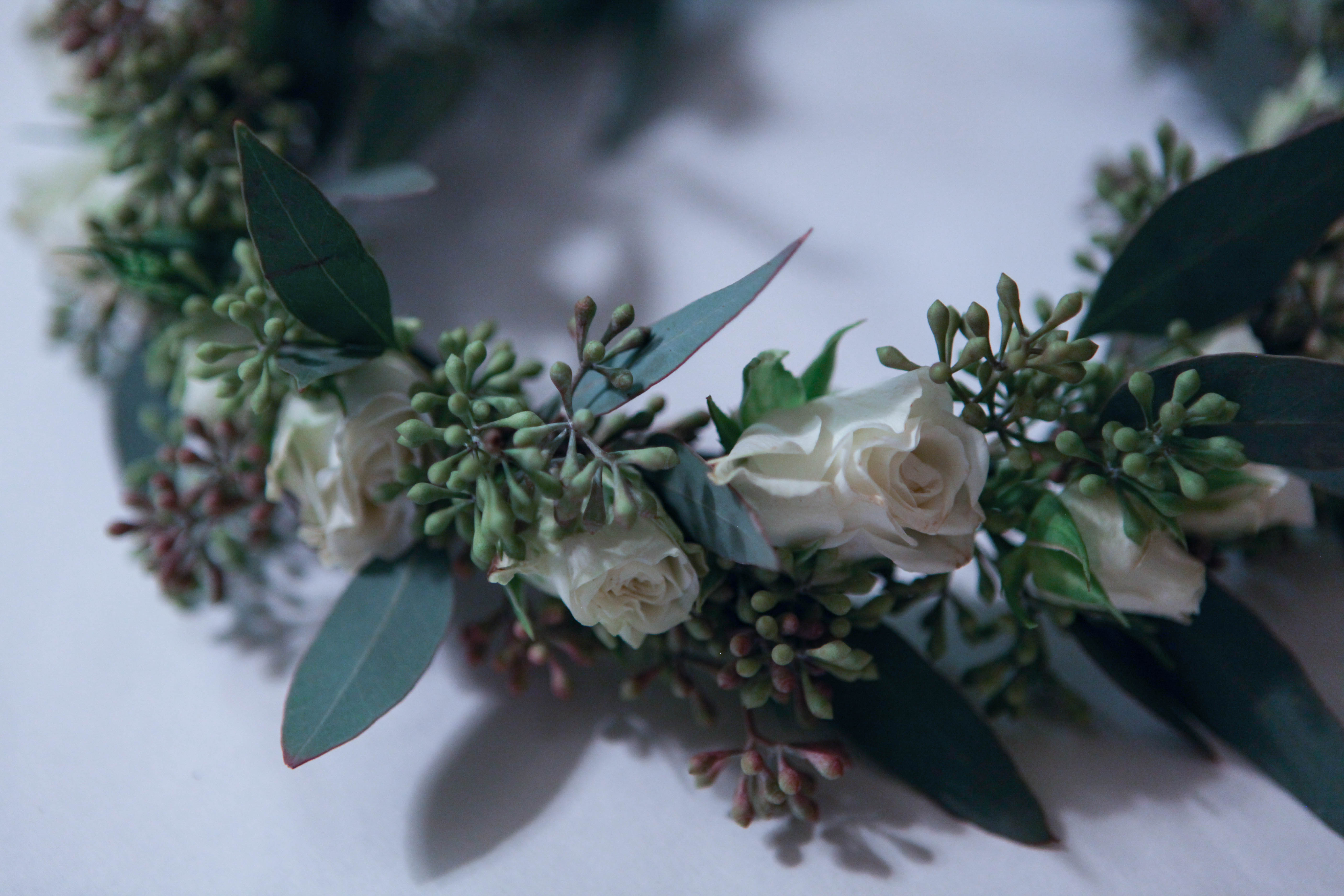 Flower Crown Made With Seeded Eucalyptus And White Spray Roses