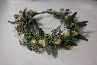 Flower crown made with seeded eucalyptus and white spray roses   designed by Natasha Price of alaskaknitnat.com