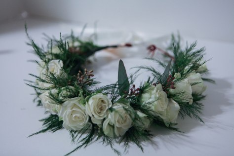 Flower crown made with seeded eucalyptus and white spray roses | designed by Natasha Price of alaskaknitnat.com