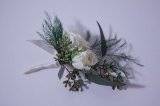 Boutonniere made with white spray rose, seeded eucalyptus and tree fern   designed by Natasha Price of alaskaknitnat.com