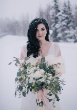 The perfect winter wedding bouquet | roses, stock, waxflower and carnation mixed with eucalyptus. Flowers by Natasha Price and photo by Erica Rose Photography