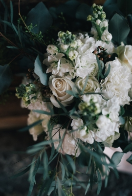 The perfect winter wedding bouquet | roses, stock, waxflower and carnation mixed with eucalytpus. Flowers by Natasha Price and photo by Erica Rose Photography