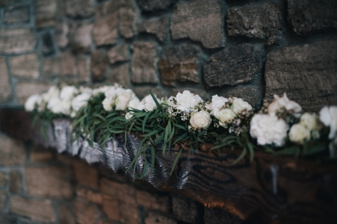 A winter wedding mantle garland made with willow eucalyptus, spray rose and waxflower | designed by Natasha Price and photo by Erica Rose Photography