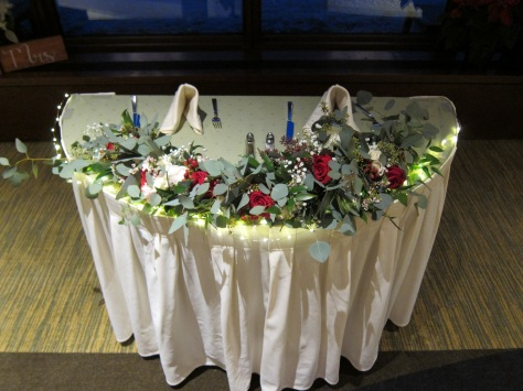 Sweetheart table garland made with roses, waxflower, hypericum berry, baby's breath and eucalyptus | designed by Natasha Price